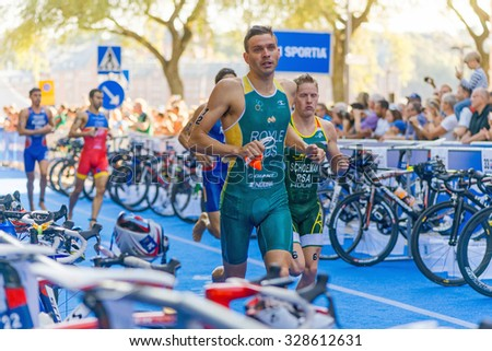 STOCKHOLM, SWEDEN - AUG 22, 2015: Aaron Royle from Australia at the transition in the Men's ITU World Triathlon series event - stock photo