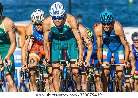 STOCKHOLM, SWEDEN - AUG 22, 2015: Aaron Royle leading before Javier Gomez in the peleton at the Men's ITU World Triathlon series event