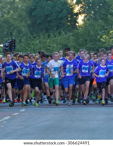 STOCKHOLM, SWEDEN - AUG 15, 2015: Group of concentrated 15 year old girls and boys after the start of the running event Midnattsloppet, August 15, 2015 in Stockholm, Sweden