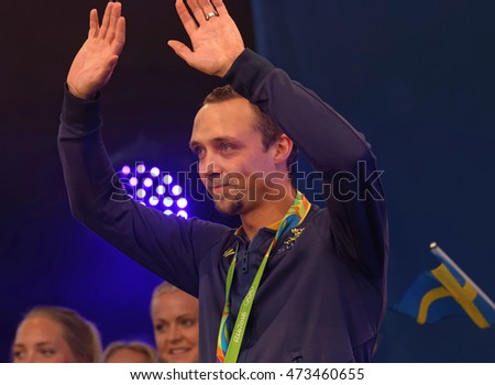 STOCKHOLM, SWEDEN - AUG 21, 2016: Happy swedish male skeet shooter Marcus Svensson when swedish olympic athletes are celebrated in Kungstradgarden, Stockholm,Sweden,August 21,2016