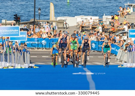 STOCKHOLM, SWEDEN - AUG 22, 2015: Hunter Kemper and Hunter Lussi from the USA into the transition area at the Men's ITU World Triathlon series event