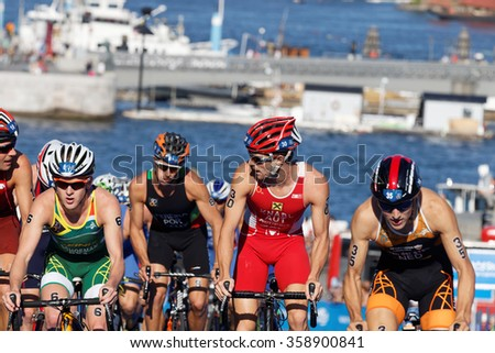 STOCKHOLM, SWEDEN - AUG 23, 2015: Schoeman, Knabl, Pereira and a group of triathlon competitors cycling uphill in the Men's ITU World Triathlon series event August 23, 2015 in Stockholm, Sweden
