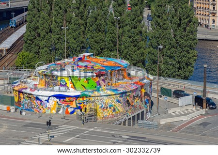 STOCKHOLM, SWEDEN - AUGUST 1, 2015: Above view of Kolingsborg before destruction, Grafitti painters was allowed to paint the building. - stock photo