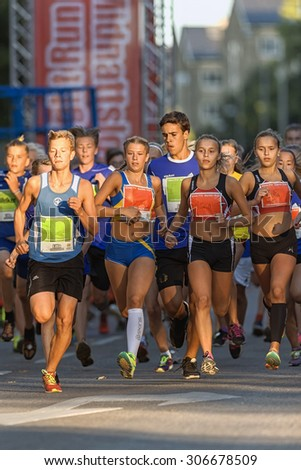 STOCKHOLM, SWEDEN - AUGUST 15, 2015: Front group just after the start at Lilla Midnattsloppet for aged 14. The track is 1775 meters and the runners are aged 8-15 years. - stock photo