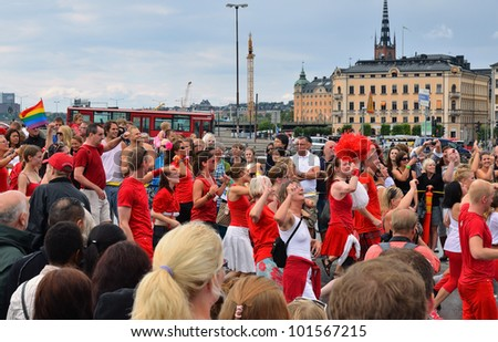 STOCKHOLM, SWEDEN - AUGUST 06: Participants and spectators of The gay pride parade on August 06, 2011 in Stockholm, Sweden - stock photo