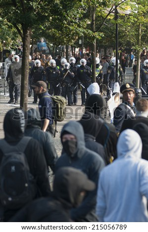 STOCKHOLM, SWEDEN - AUGUST 30: Protests against Neo-Nazi demonstration in Stockholm, Sweden, August 30, 2014. - stock photo