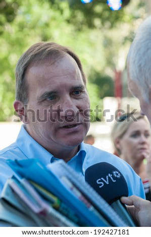 STOCKHOLM, SWEDEN - AUGUST 25: Stefan Lofven, party leader for the Swedish Social Democrats is interviewed by the press after his summer speech in Vasaparken, Stockholm, August 25, 2013.  - stock photo