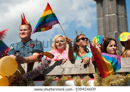 STOCKHOLM, SWEDEN - AUGUST 4: Stockholm Pride Parade 2012 on August 4, 2012 in Stockholm attracts 50000 participants and 500000 spectators. - stock photo