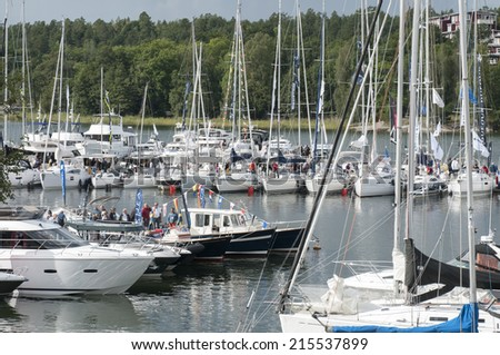 "STOCKHOLM, SWEDEN - AUGUST 29: Swedens largest floating boat show ""All at Sea"" will run for three days in Gustavsberg Harbour, outside Stockholm in Sweden, August 29,2014. - stock photo"