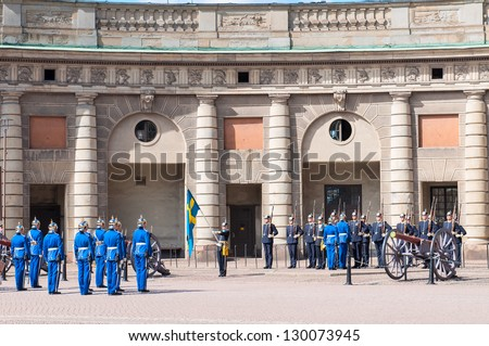 STOCKHOLM, SWEDEN - AUGUST 25: The ceremony of changing of the Royal Guard. This ceremony is daily and takes place in front of the Royal Palace at 12 p.m and attracts thousands of tourists