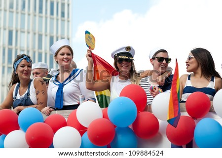 STOCKHOLM, SWEDEN - AUGUST 4: Women dressed as sailors at Stockholm Pride Parade on August 4, 2012 in Stockholm which attracts an estimated 50000 participants and 500000 spectators.