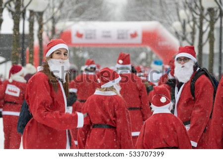 Stockholm, Sweden - Dec 11, 2016 : Stockholm Santa Run, a non competitive charity run for everyone, 2016 at Kungstradgarden Park, Stockholm, Sweden.