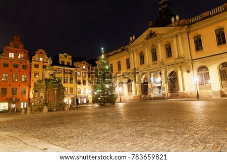 STOCKHOLM, SWEDEN - DEC 27, 2017: The medieval square Stortorget and the Nobel Museum in the Old Town during night in central Stockholm, Sweden, December 27, 2017