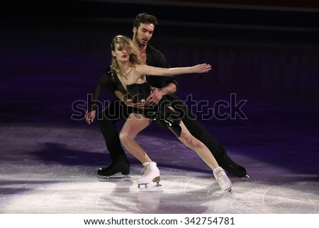 STOCKHOLM, SWEDEN - FEBRUARY 1, 2015: Gabriella PAPADAKIS / Guillaume CIZERON of France perform during the Exhibition Gala at ISU European Figure Skating Championship in Globen Arena. - stock photo