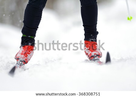 STOCKHOLM, SWEDEN - JAN 24, 2016: Detail of legs and feet at the Ski Marathon in crosscountry skiing classic style. - stock photo