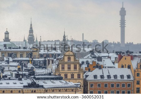 STOCKHOLM, SWEDEN - JAN 8, 2015: Snowy rooftops at Stockholm Old Town. - stock photo