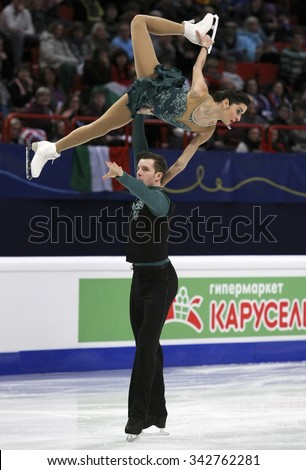 STOCKHOLM, SWEDEN - JANUARY 30, 2015: Valentina MARCHEI / Ondrej HOTAREK of Italy perform during pairs short program at ISU European Figure Skating Championship in Globen Arena. - stock photo