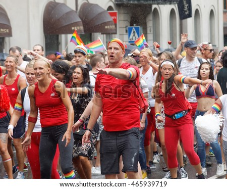 STOCKHOLM, SWEDEN - JUL 30, 2016: Group of dancing people from the Friskis & Svettis organisation in the Pride parade July 30, 2016 in Stockholm, Sweden