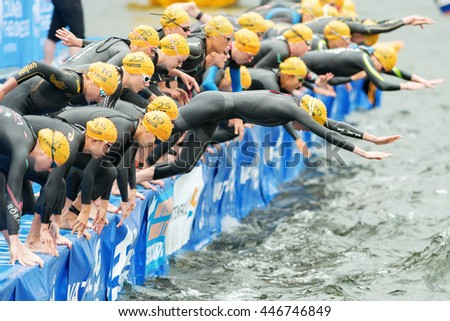 STOCKHOLM, SWEDEN - JULY 02, 2016: After the start with Aileen Reid (IRL) first out of the Women ITU Triathlon event in Stockholm with the swimming. - stock photo