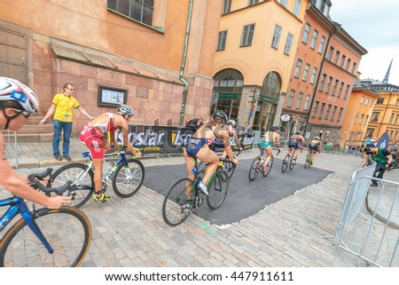 STOCKHOLM, SWEDEN - JULY 02, 2016: Group of cyclists passing by in the old town at the Women ITU Triathlon event in Stockholm.