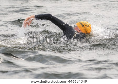STOCKHOLM, SWEDEN - JULY 02, 2016: Laura Lindemann (GER) doing a warmup crawl in the water before the start at Women ITU Triathlon event in Stockholm.