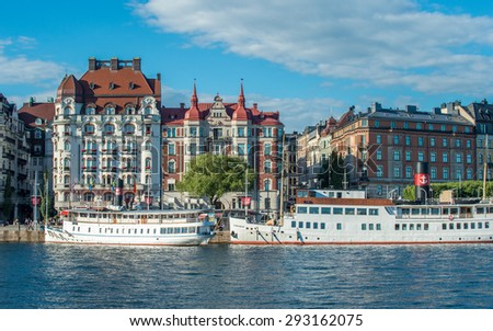 STOCKHOLM, SWEDEN - JULY 1: Summer evening at Nybroviken on July 1, 2015 in Stockholm. Some of the cityâ??s most fashionable addresses are found along Strandvägen at the opposite side of the water. - stock photo