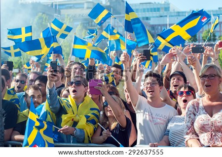 STOCKHOLM, SWEDEN - JULY 1: Thousands of Swedish football fans welcome back the Sweden players on July 1, 2015 in Stockholm. The team won the country's first UEFA European Under-21 Championship title.