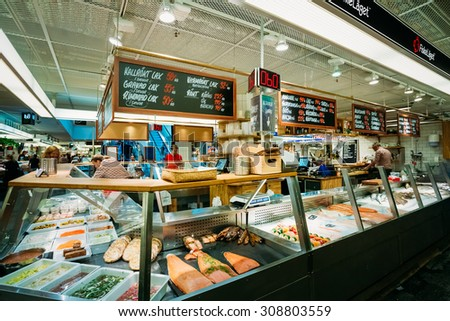 STOCKHOLM, SWEDEN - JULY 30, 2014: Trade in traditional Swedish food seafood in the local Hay Market Hotorget.