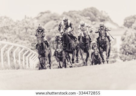 STOCKHOLM, SWEDEN - JUN 6, 2015: Horses with jockeys out of a curve in fast pace at Nationaldagsgaloppen at Gardet. Sepia filter applied - stock photo