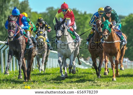 STOCKHOLM, SWEDEN - JUN 6, 2017: Horses with jockeys out of a curve in fast pace at Nationaldagsgaloppen at Gardet.