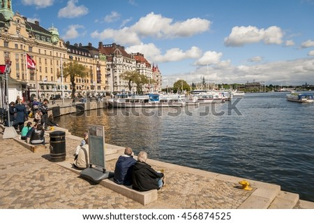 STOCKHOLM, SWEDEN. June 8, 2015. People sitting in the Riddarfjarden's bay embankment.