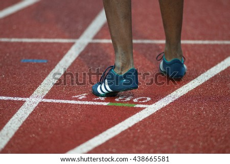 STOCKHOLM, SWEDEN - JUNE 16, 2016: Shoe of an athlete sprinter on a track and field start at the IAAF Diamond League in Stockholm. - stock photo