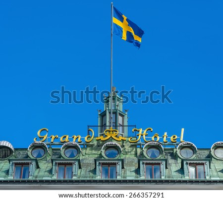 STOCKHOLM, SWEDEN - MAR 31: Grand Hotel sign with the swedish flag, March 31, 2015 in Stockholm, Sweden. Since 1901, the Nobel Prize laureates and their families have been guests at the hotel - stock photo
