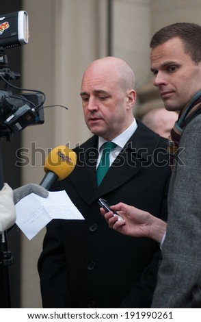 STOCKHOLM, SWEDEN - MARCH 2:Prime Minister Fredrik Reinfeldt, Sweden is interviewed on March 2, 2014 outside the Royal palace, Stockholm by reason of the situation in Ukraine.  - stock photo