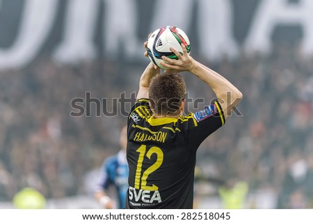 STOCKHOLM, SWEDEN - MAY 25: AIK player Haukur Hauksson throws in the ball in the game DIF vs AIK at Tele2 arena on May 25, 2015. Bangura scored the 0-2 goal. - stock photo