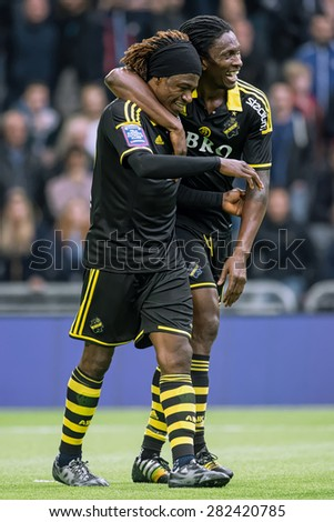 STOCKHOLM, SWEDEN - MAY 25: AIK striker Mohammed Bangura celebrating with Ofori after his goal in the game DIF vs AIK at Tele2 arena on May 25, 2015. Bangura scored the 0-2 goal.