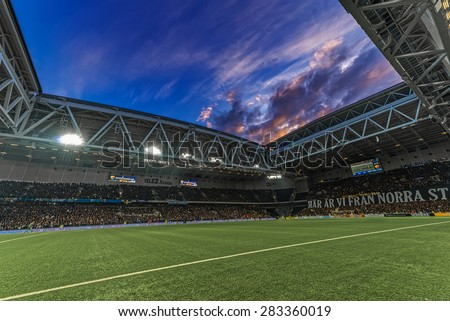 STOCKHOLM, SWEDEN - MAY 25: Dramatic blue sky on Tele2 arena from the pitch during evening at the soccer game between DIF and AIK during evening on May 25, 2015.