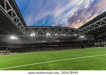 STOCKHOLM, SWEDEN - MAY 25: Dramatic sky over Tele2 arena during the football game between DIF and AIK at the evening on May 25, 2015. Final result 2-2. - stock photo