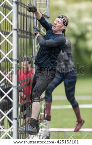 STOCKHOLM, SWEDEN - MAY 14, 2016 Net climb at Tough Viking obstacle course around Stockholm Stadion. - stock photo