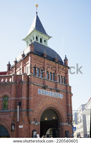 STOCKHOLM, SWEDEN - MAY 16, 2014: Stermalms Saluhall, a market hall a beautiful 1880s red brick building. - stock photo