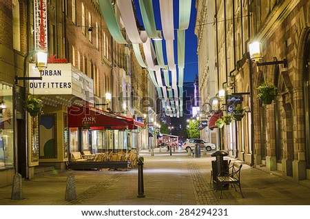STOCKHOLM, SWEDEN - MAY 27: The most popular shopping street with ribbon decorations in Stockholm at night, May 27, 2015 in Stockholm, Sweden. - stock photo