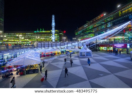 STOCKHOLM, SWEDEN - NOV 26: Christmas atmosphere of the city at night. The night holiday illumination. Christmas Fair at night. Sergels torg. Stockholm. Sweden. Europe. November 26, 2010