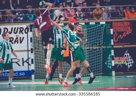 STOCKHOLM, SWEDEN - NOV 4, 2015: Hammarby defence tries to block at the Handball game between Hammarby vs Lugi at Eriksdalshallen. Allsvenskan Swedish leugue - stock photo