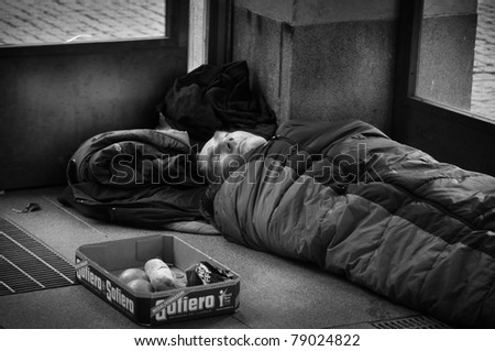 STOCKHOLM, SWEDEN - OCT. 29: An unidentified homeless man sleeping at the entrance to the subway in Stockholm, Sweden on October 29, 2010. There are about 5,000 homeless people in Stockholm, where the population is 1.3 million.