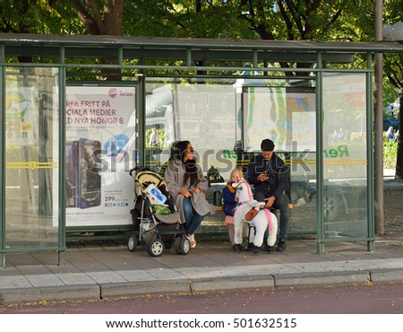 STOCKHOLM, SWEDEN - OCT 3, 2016: Swedish horse with happy child at bus stop