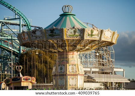 STOCKHOLM, SWEDEN - OCTOBER 11, 2015:  Carousel in the amusement park of Grona Lund in Stockholm, Sweden. This is the most popular city-center amusement park in Sweden and has over 30 attractions. - stock photo