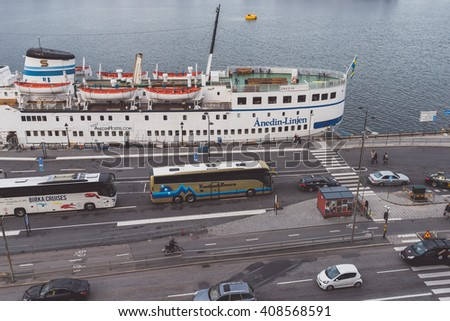 STOCKHOLM, SWEDEN - OCTOBER 13, 2015:  Cruise terminal in Stockholm (Stadsgarden). Cloudy autumn evening.