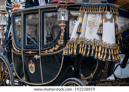 STOCKHOLM, SWEDEN - SEPTEMBER 17: The formal start of the parliamentary year. King Carl XVI Gustaf of Sweden and Queen Silvia arrives by carriage to the house of parliament on September 17, 2013.  - stock photo