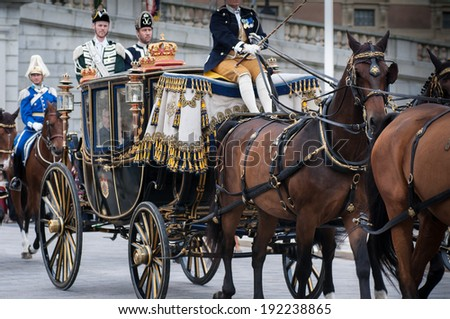 STOCKHOLM, SWEDEN - SEPTEMBER 17: The formal start of the parliamentary year. King Carl XVI Gustaf of Sweden and Queen Silvia arrives by carriage to the house of parliament September 17, 2013.  - stock photo