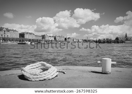 Stockholm, Sweden. Strandvagen part of capital city with Djurgarden visible on the right. Black and white tone - retro monochrome style.
